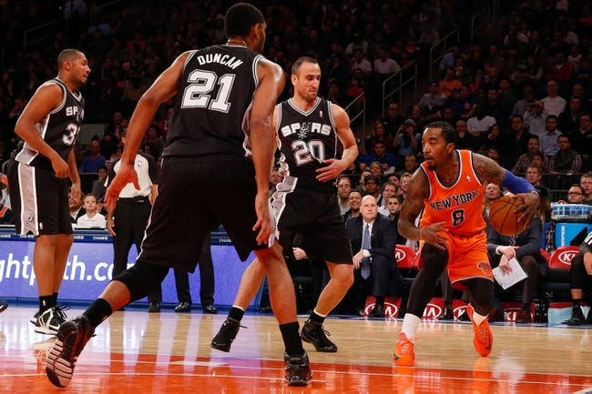 Nov 10, 2013; New York, NY, USA;  New York Knicks shooting guard J.R. Smith (8) steps back during the first quarter against the San Antonio Spurs at Madison Square Garden. Mandatory Credit: Anthony Gruppuso-USA TODAY Sports