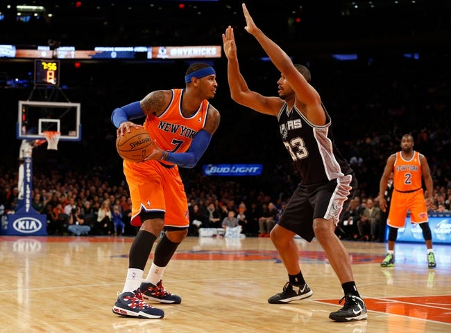 Nov 10, 2013; New York, NY, USA; New York Knicks small forward Carmelo Anthony (7) looks to go around San Antonio Spurs power forward Boris Diaw (33) during the first quarter at Madison Square Garden. Mandatory Credit: Anthony Gruppuso-USA TODAY Sports