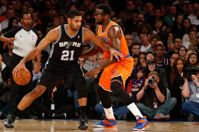 Nov 10, 2013; New York, NY, USA;  San Antonio Spurs power forward Tim Duncan (21) drives around New York Knicks power forward Amar'e Stoudemire (1) during the second quarter at Madison Square Garden. Mandatory Credit: Anthony Gruppuso-USA TODAY Sports