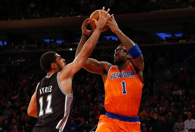 Nov 10, 2013; New York, NY, USA;  San Antonio Spurs power forward Jeff Ayres (11) keeps New York Knicks power forward Amar'e Stoudemire (1) from the basket during the second quarter at Madison Square Garden. Mandatory Credit: Anthony Gruppuso-USA TODAY Sports