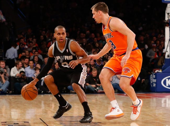 Nov 10, 2013; New York, NY, USA;  San Antonio Spurs point guard Patty Mills (8) drives around New York Knicks point guard Beno Udrih (18) during the third quarter at Madison Square Garden. Spurs won 120-89.  Mandatory Credit: Anthony Gruppuso-USA TODAY Sports