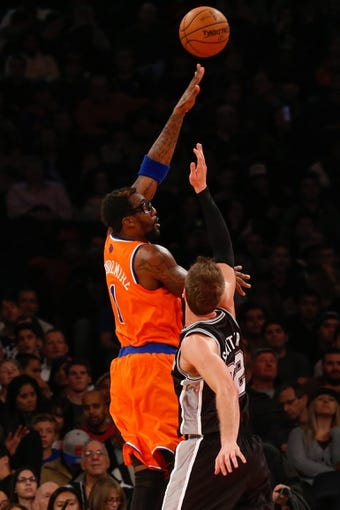Nov 10, 2013; New York, NY, USA;  New York Knicks power forward Amar'e Stoudemire (1) shoots over San Antonio Spurs center Tiago Splitter (22) during the fourth quarter at Madison Square Garden. Spurs won 120-89.  Mandatory Credit: Anthony Gruppuso-USA TODAY Sports