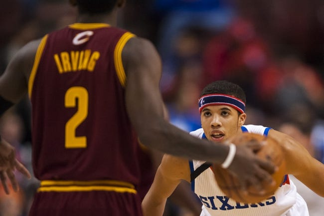 Nov 8, 2013; Philadelphia, PA, USA; Philadelphia 76ers guard Michael Carter-Williams (1) defends the dribble of Cleveland Cavaliers guard Kyrie Irving (2) during the first quarter at Wells Fargo Center. The Sixers defeated the Cavaliers 94-79. Mandatory Credit: Howard Smith-USA TODAY Sports