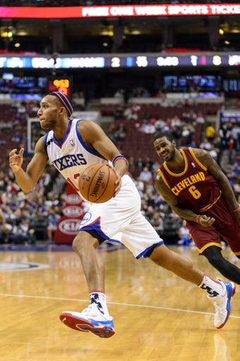 Nov 8, 2013; Philadelphia, PA, USA; Philadelphia 76ers guard Evan Turner (12) during the first quarter against the Cleveland Cavaliers at Wells Fargo Center. The Sixers defeated the Cavaliers 94-79. Mandatory Credit: Howard Smith-USA TODAY Sports