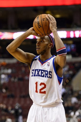 Nov 8, 2013; Philadelphia, PA, USA; Philadelphia 76ers guard Evan Turner (12) looks to pass during the first quarter against the Cleveland Cavaliers at Wells Fargo Center. The Sixers defeated the Cavaliers 94-79. Mandatory Credit: Howard Smith-USA TODAY Sports
