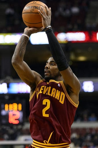 Nov 8, 2013; Philadelphia, PA, USA; Cleveland Cavaliers guard Kyrie Irving (2) shoots a jump shot during the third quarter against the Philadelphia 76ers at Wells Fargo Center. The Sixers defeated the Cavaliers 94-79. Mandatory Credit: Howard Smith-USA TODAY Sports