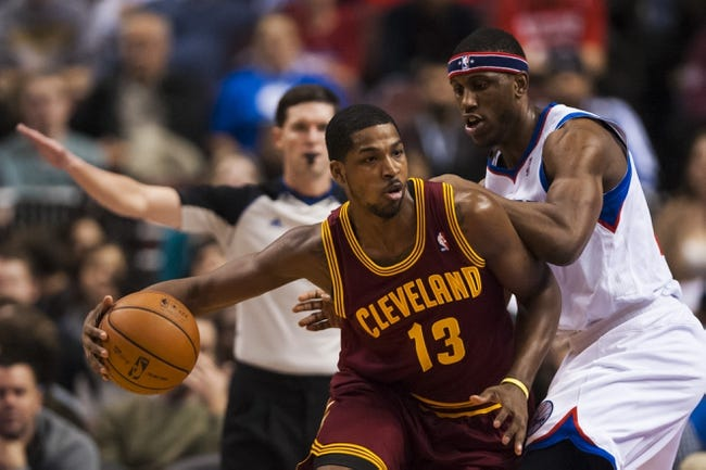Nov 8, 2013; Philadelphia, PA, USA; Cleveland Cavaliers forward Tristan Thompson (13) is defended by Philadelphia 76ers forward Thaddeus Young (21) during the first quarter at Wells Fargo Center. The Sixers defeated the Cavaliers 94-79. Mandatory Credit: Howard Smith-USA TODAY Sports