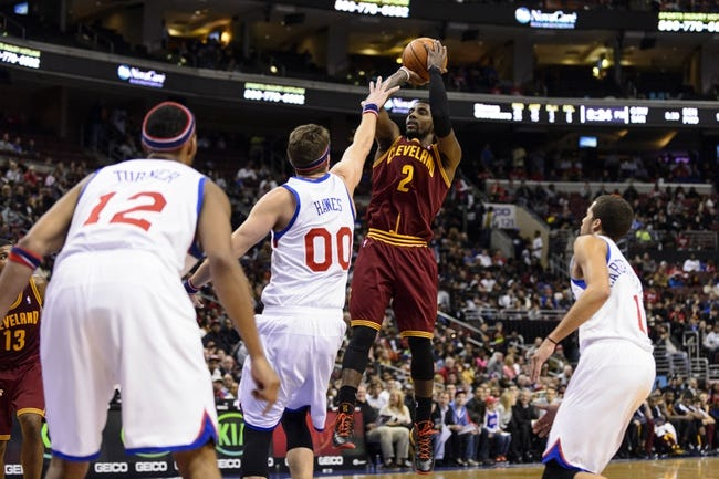 Nov 8, 2013; Philadelphia, PA, USA; Cleveland Cavaliers guard Kyrie Irving (2) shoots a jump shot over the defense of Philadelphia 76ers center Spencer Hawes (00) during the third quarter at Wells Fargo Center. The Sixers defeated the Cavaliers 94-79. Mandatory Credit: Howard Smith-USA TODAY Sports