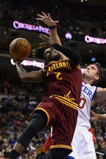 Nov 8, 2013; Philadelphia, PA, USA; Cleveland Cavaliers guard Kyrie Irving (2) shoots under pressure from Philadelphia 76ers center Spencer Hawes (00) during the fourth quarter at Wells Fargo Center. The Sixers defeated the Cavaliers 94-79. Mandatory Credit: Howard Smith-USA TODAY Sports