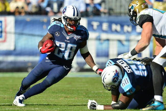 Nov 10, 2013; Nashville, TN, USA; Tennessee Titans running back Chris Johnson (28) carries the ball against the Jacksonville Jaguars during the first half at LP Field. The Jaguars beat the Titans 29-27. Mandatory Credit: Don McPeak-USA TODAY Sports