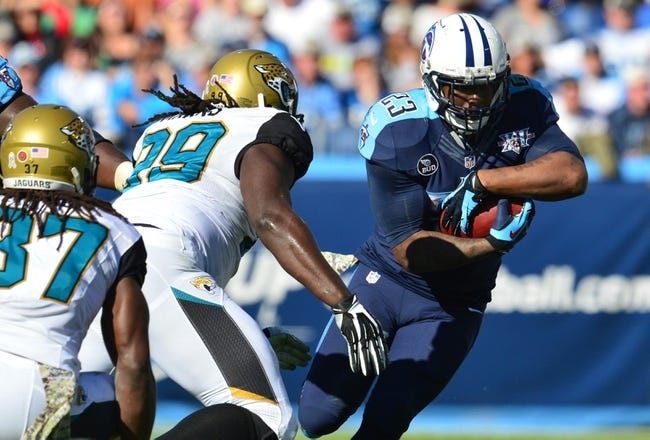Nov 10, 2013; Nashville, TN, USA; Tennessee Titans running back Shonn Greene (23) carries the ball against Jacksonville Jaguars defensive tackle Sen'Derrick Marks (99) during the first half at LP Field. The Jaguars beat the Titans 29-27. Mandatory Credit: Don McPeak-USA TODAY Sports