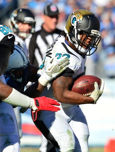 Nov 10, 2013; Nashville, TN, USA; Jacksonville Jaguars running back Maurice Jones-Drew (32) carries the ball against the Tennessee Titans during the second half at LP Field. The Jaguars beat the Titans 29-27. Mandatory Credit: Don McPeak-USA TODAY Sports