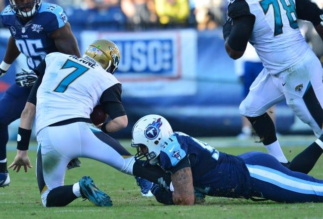 Nov 10, 2013; Nashville, TN, USA; Tennessee Titans defensive end Derrick Morgan (91) tackles Jacksonville Jaguars quarterback Chad Henne (7) during the second half at LP Field. The Jaguars beat the Titans 29-27. Mandatory Credit: Don McPeak-USA TODAY Sports