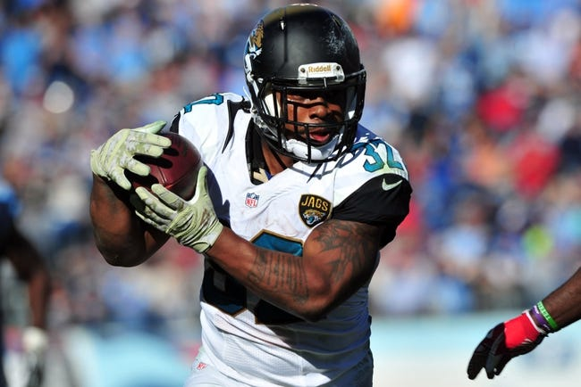 Nov 10, 2013; Nashville, TN, USA; Jacksonville Jaguars running back Maurice Jones-Drew (32) carries the ball against the Tennessee Titans during the first half at LP Field. The Jaguars beat the Titans 29-27. Mandatory Credit: Don McPeak-USA TODAY Sports