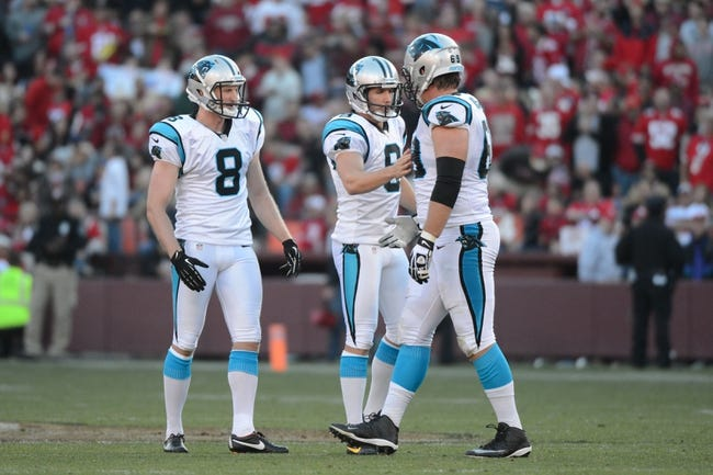 November 10, 2013; San Francisco, CA, USA; Carolina Panthers punter Brad Nortman (8), kicker Graham Gano (9), and tackle Jordan Gross (69) celebrate after Gano kicked the game-winning field goal during the fourth quarter against the San Francisco 49ers at Candlestick Park. The Panthers defeated the 49ers 10-9. Mandatory Credit: Kyle Terada-USA TODAY Sports