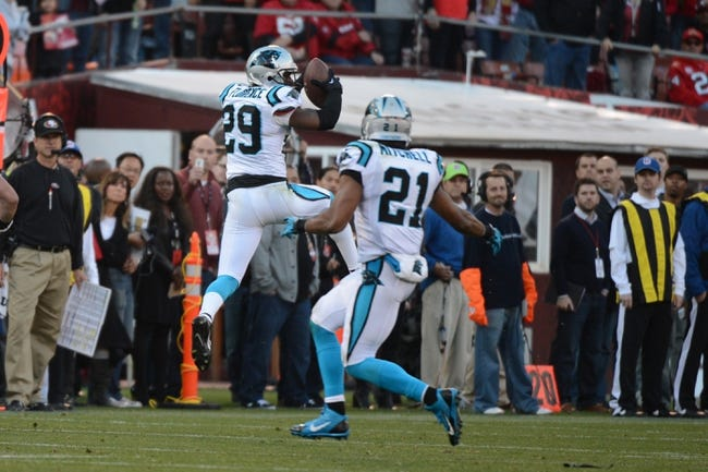 November 10, 2013; San Francisco, CA, USA; Carolina Panthers cornerback Drayton Florence (29) intercepts the ball during the fourth quarter against the San Francisco 49ers at Candlestick Park. The Panthers defeated the 49ers 10-9. Mandatory Credit: Kyle Terada-USA TODAY Sports