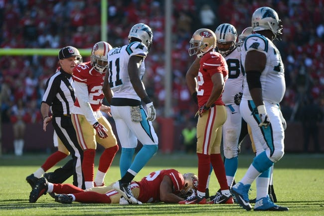 November 10, 2013; San Francisco, CA, USA; San Francisco 49ers free safety Eric Reid (35) on the ground injured against the Carolina Panthers during the third quarter at Candlestick Park. The Panthers defeated the 49ers 10-9. Mandatory Credit: Kyle Terada-USA TODAY Sports