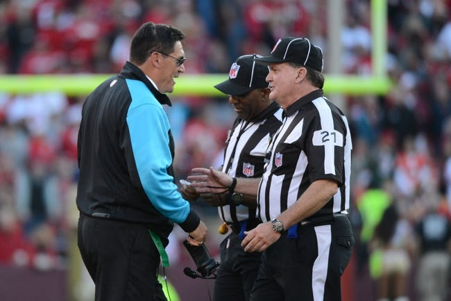 November 10, 2013; San Francisco, CA, USA; Carolina Panthers head coach Ron Rivera (left) talks to head linesman John Schleyer (21) during the fourth quarter against the San Francisco 49ers at Candlestick Park. The Panthers defeated the 49ers 10-9. Mandatory Credit: Kyle Terada-USA TODAY Sports