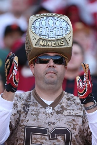 Nov 10, 2013; San Francisco, CA, USA; San Francisco 49ers fan during the third quarter against the Carolina Panthers at Candlestick Park. The Carolina Panthers defeated the San Francisco 49ers 10-9. Mandatory Credit: Kelley L Cox-USA TODAY Sports