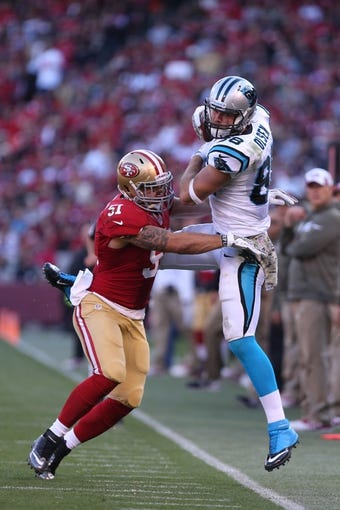 Nov 10, 2013; San Francisco, CA, USA; San Francisco 49ers outside linebacker Dan Skuta (51) pushes Carolina Panthers tight end Greg Olsen (88) out of bounds for an incomplete pass during the fourth quarter at Candlestick Park. The Carolina Panthers defeated the San Francisco 49ers 10-9. Mandatory Credit: Kelley L Cox-USA TODAY Sports