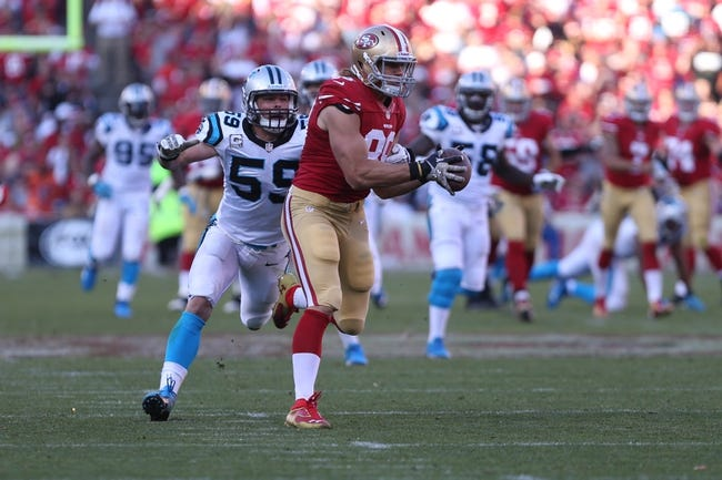 Nov 10, 2013; San Francisco, CA, USA; San Francisco 49ers tight end Vance McDonald (89) is unable to control the ball ahead of Carolina Panthers middle linebacker Luke Kuechly (59) during the fourth quarter at Candlestick Park. The Carolina Panthers defeated the San Francisco 49ers 10-9. Mandatory Credit: Kelley L Cox-USA TODAY Sports
