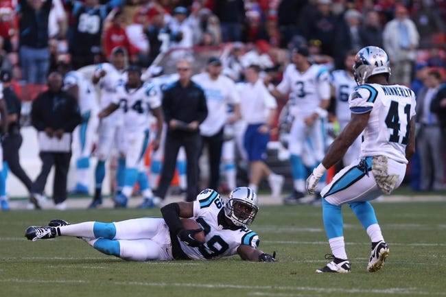 Nov 10, 2013; San Francisco, CA, USA; Carolina Panthers cornerback Drayton Florence (29) slides after intercepting the ball in the final seconds against the San Francisco 49ers during the fourth quarter at Candlestick Park. The Carolina Panthers defeated the San Francisco 49ers 10-9. Mandatory Credit: Kelley L Cox-USA TODAY Sports