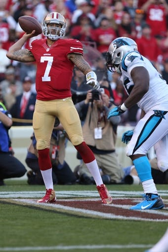 Nov 10, 2013; San Francisco, CA, USA; San Francisco 49ers quarterback Colin Kaepernick (7) throws for an incomplete pass from the endzone against the Carolina Panthers during the fourth quarter at Candlestick Park. The Carolina Panthers defeated the San Francisco 49ers 10-9. Mandatory Credit: Kelley L Cox-USA TODAY Sports