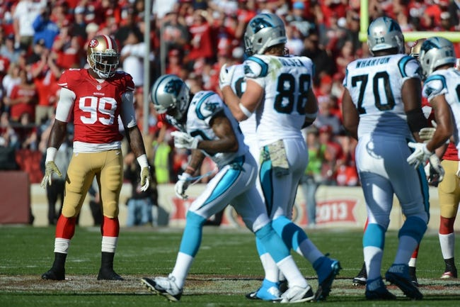 November 10, 2013; San Francisco, CA, USA; San Francisco 49ers outside linebacker Aldon Smith (99) looks on as the Carolina Panthers offense approaches the line of scrimmage during the second quarter at Candlestick Park. The Panthers defeated the 49ers 10-9. Mandatory Credit: Kyle Terada-USA TODAY Sports