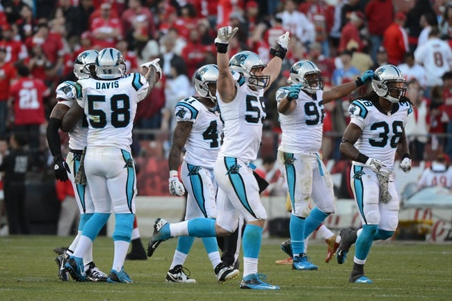 November 10, 2013; San Francisco, CA, USA; Carolina Panthers middle linebacker Luke Kuechly (59) celebrates with his teammates after an interception by cornerback Drayton Florence (29, not pictured) during the fourth quarter against the San Francisco 49ers at Candlestick Park. The Panthers defeated the 49ers 10-9. Mandatory Credit: Kyle Terada-USA TODAY Sports