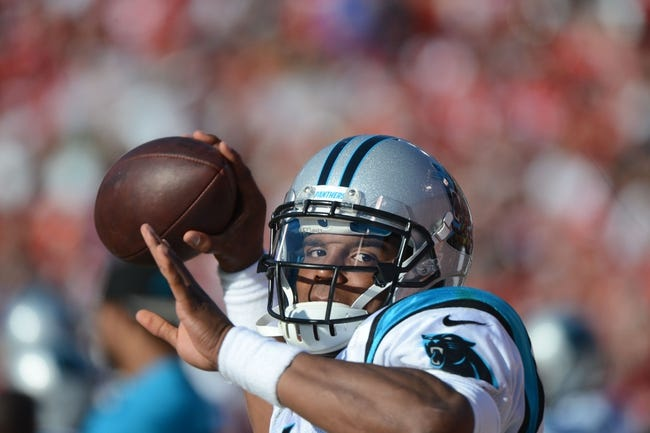 November 10, 2013; San Francisco, CA, USA; Carolina Panthers quarterback Cam Newton (1) warms up on the sideline against the San Francisco 49ers during the third quarter at Candlestick Park. The Panthers defeated the 49ers 10-9. Mandatory Credit: Kyle Terada-USA TODAY Sports