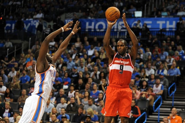 Nov 10, 2013; Oklahoma City, OK, USA; Washington Wizards small forward Martell Webster (9) attempts a shot against Oklahoma City Thunder point guard Reggie Jackson (15) during the second quarter at Chesapeake Energy Arena. Mandatory Credit: Mark D. Smith-USA TODAY Sports