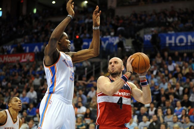 Nov 10, 2013; Oklahoma City, OK, USA; Washington Wizards center Marcin Gortat (4) attempts a shot against Oklahoma City Thunder small forward Kevin Durant (35) during the second quarter at Chesapeake Energy Arena. Mandatory Credit: Mark D. Smith-USA TODAY Sports