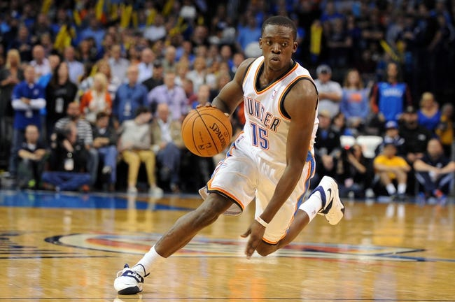 Nov 10, 2013; Oklahoma City, OK, USA; Oklahoma City Thunder point guard Reggie Jackson (15) handles the ball against the Washington Wizards during the third quarter at Chesapeake Energy Arena. Mandatory Credit: Mark D. Smith-USA TODAY Sports