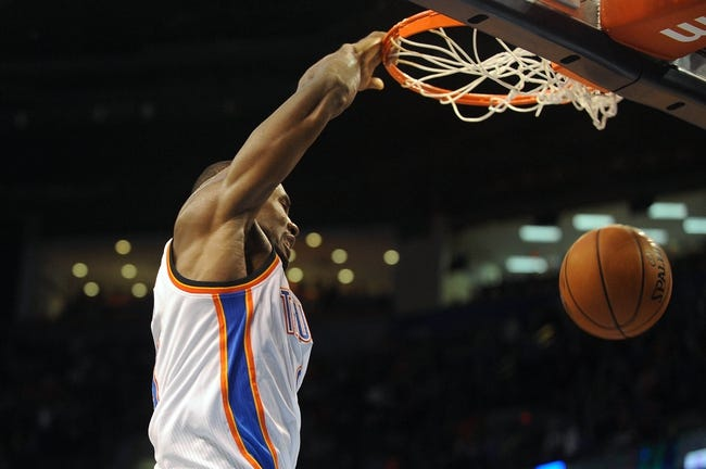 Nov 10, 2013; Oklahoma City, OK, USA; Oklahoma City Thunder power forward Serge Ibaka (9) dunks the ball against the Washington Wizards during the fourth quarter at Chesapeake Energy Arena. Mandatory Credit: Mark D. Smith-USA TODAY Sports