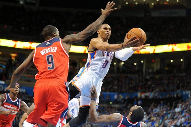 Nov 10, 2013; Oklahoma City, OK, USA; Oklahoma City Thunder point guard Russell Westbrook (0) attempts a shot against Washington Wizards small forward Martell Webster (9) during the third quarter at Chesapeake Energy Arena. Mandatory Credit: Mark D. Smith-USA TODAY Sports