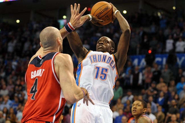 Nov 10, 2013; Oklahoma City, OK, USA; Oklahoma City Thunder point guard Reggie Jackson (15) attempts a shot against Washington Wizards center Marcin Gortat (4) during the fourth quarter at Chesapeake Energy Arena. Mandatory Credit: Mark D. Smith-USA TODAY Sports