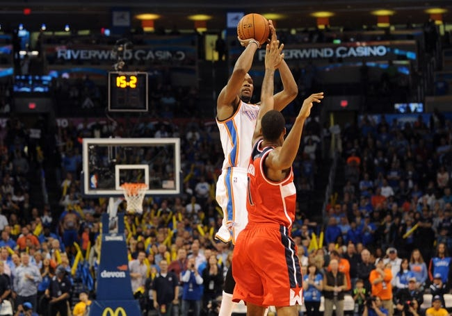 Nov 10, 2013; Oklahoma City, OK, USA; Oklahoma City Thunder small forward Kevin Durant (35) shoots the tying 3 point shot to force overtime against Washington Wizards small forward Trevor Ariza (1) at Chesapeake Energy Arena. Mandatory Credit: Mark D. Smith-USA TODAY Sports