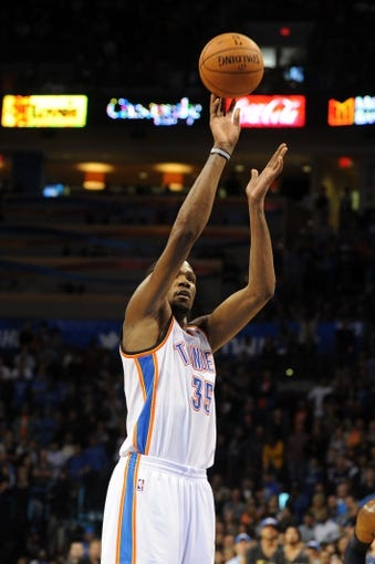 Nov 10, 2013; Oklahoma City, OK, USA; Oklahoma City Thunder small forward Kevin Durant (35) attempts a shot against the Washington Wizards during overtime at Chesapeake Energy Arena. Mandatory Credit: Mark D. Smith-USA TODAY Sports