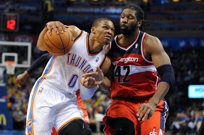 Nov 10, 2013; Oklahoma City, OK, USA; Oklahoma City Thunder point guard Russell Westbrook (0) handles the ball against Washington Wizards power forward Nene Hilario (42) during the fourth quarter at Chesapeake Energy Arena. Mandatory Credit: Mark D. Smith-USA TODAY Sports