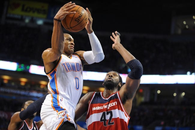 Nov 10, 2013; Oklahoma City, OK, USA; Oklahoma City Thunder point guard Russell Westbrook (0) shoots the ball against Washington Wizards power forward Nene Hilario (42) during the fourth quarter at Chesapeake Energy Arena. Mandatory Credit: Mark D. Smith-USA TODAY Sports