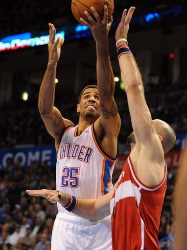 Nov 10, 2013; Oklahoma City, OK, USA; Oklahoma City Thunder shooting guard Thabo Sefolosha (25) attempts a shot against Washington Wizards center Marcin Gortat (4) during the third quarter at Chesapeake Energy Arena. Mandatory Credit: Mark D. Smith-USA TODAY Sports