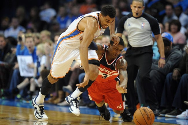 Nov 10, 2013; Oklahoma City, OK, USA; Oklahoma City Thunder shooting guard Thabo Sefolosha (25) steal the ball from Washington Wizards shooting guard Bradley Beal (3) during the fourth quarter at Chesapeake Energy Arena. Mandatory Credit: Mark D. Smith-USA TODAY Sports