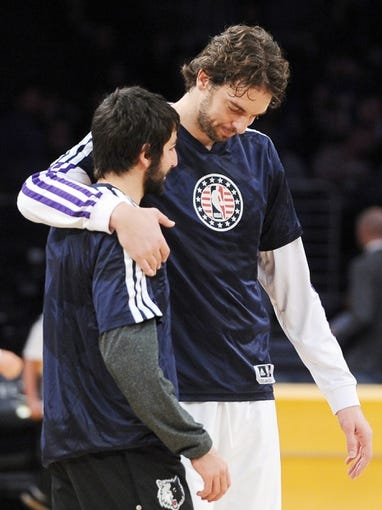 Nov 10, 2013; Los Angeles, CA, USA;  Los Angeles Lakers center Pau Gasol (16) and Minnesota Timberwolves point guard Ricky Rubio (9) before the start of the game at Staples Center. Timberwolves won 113-90. Mandatory Credit: Jayne Kamin-Oncea-USA TODAY Sports