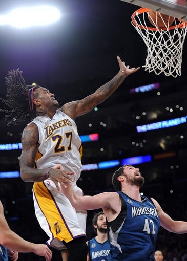 Nov 10, 2013; Los Angeles, CA, USA;  Los Angeles Lakers center Jordan Hill (27) tips in the ball past Minnesota Timberwolves power forward Kevin Love (42) in the second half of the game at Staples Center. Timberwolves won 113-90. Mandatory Credit: Jayne Kamin-Oncea-USA TODAY Sports