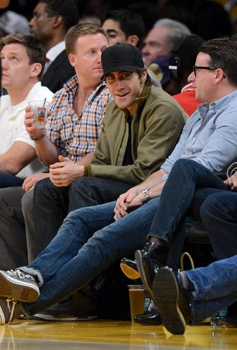 Nov 10, 2013; Los Angeles, CA, USA;  American actor Jake Gyllenhaal watches the game between the Los Angeles Lakers and the Minnesota Timberwolves at Staples Center. Timberwolves won 113-90. Mandatory Credit: Jayne Kamin-Oncea-USA TODAY Sports