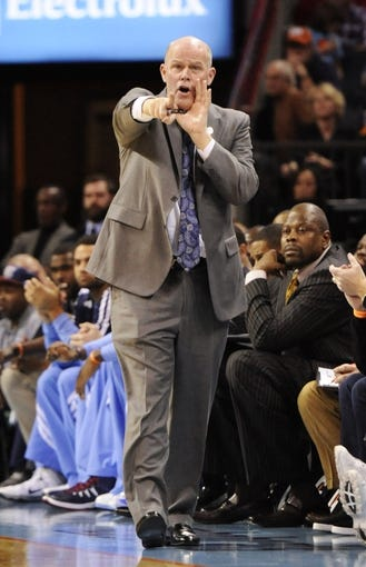 Nov 11, 2013; Charlotte, NC, USA; Charlotte Bobcats head coach Steve Clifford reacts on the sidelines against the Atlanta Hawks at Time Warner Cable Arena. Mandatory Credit: Sam Sharpe-USA TODAY Sports