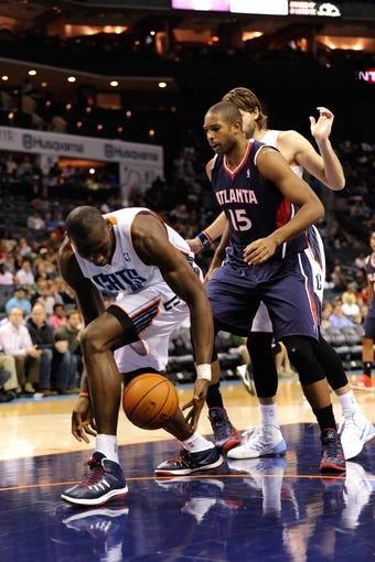 Nov 11, 2013; Charlotte, NC, USA; Charlotte Bobcats forward center Bismack Biyombo (0) and Atlanta Hawks forward center Al Horford (15) go after a loose ball during the game at Time Warner Cable Arena. Mandatory Credit: Sam Sharpe-USA TODAY Sports