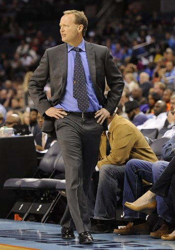 Nov 11, 2013; Charlotte, NC, USA; Atlanta Hawks head coach Mike Budenholzer walks on the sidelines during the fourth quarter against the Charlotte Bobcats at Time Warner Cable Arena. The Hawks won 103-94. Mandatory Credit: Sam Sharpe-USA TODAY Sports