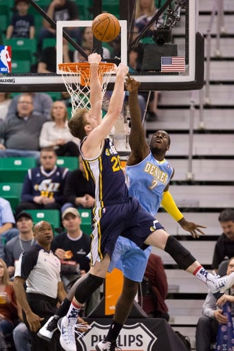 Nov 11, 2013; Salt Lake City, UT, USA; Utah Jazz shooting guard Gordon Hayward (20) goes up for a shot while defended by Denver Nuggets power forward J.J. Hickson (7) during the first half at EnergySolutions Arena. Mandatory Credit: Russ Isabella-USA TODAY Sports