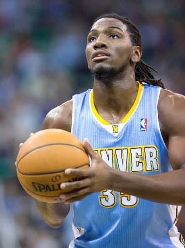 Nov 11, 2013; Salt Lake City, UT, USA; Denver Nuggets power forward Kenneth Faried (35) shoots a free throw during the first half against the Utah Jazz at EnergySolutions Arena. Mandatory Credit: Russ Isabella-USA TODAY Sports